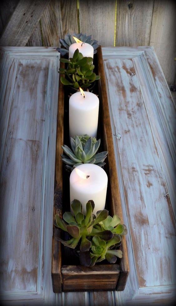 Centros de mesa con velas y madera